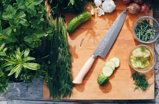 fresh green herbs on a cutting board